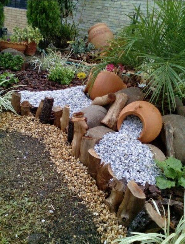 διακόσμηση στον κήπο με πέτρες και πυθάρια10