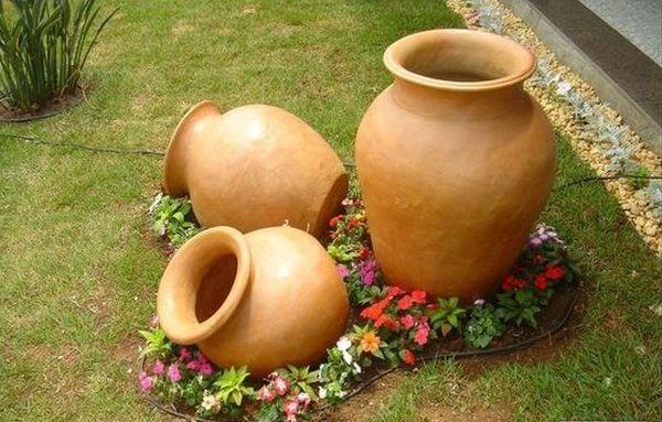 διακόσμηση στον κήπο με πέτρες και πυθάρια14