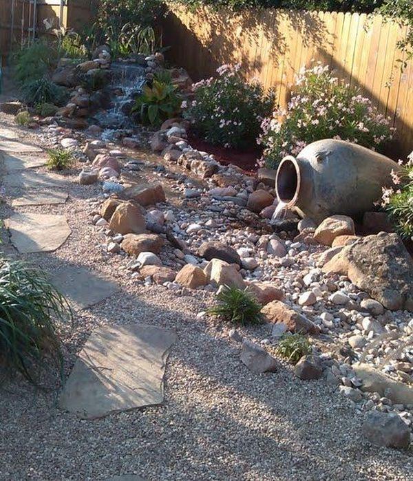 διακόσμηση στον κήπο με πέτρες και πυθάρια7