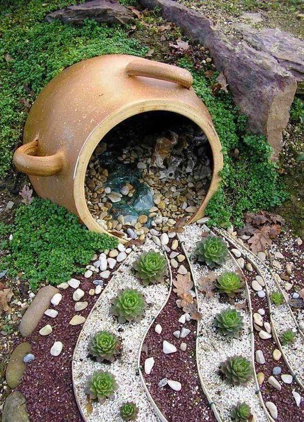 διακόσμηση στον κήπο με πέτρες και πυθάρια8