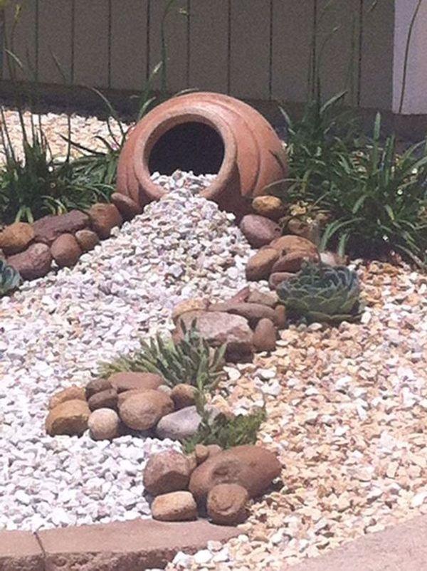 διακόσμηση στον κήπο με πέτρες και πυθάρια9
